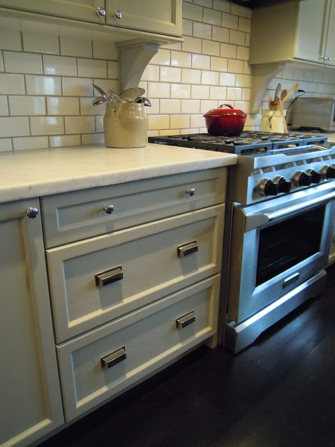 Bedford Grey by Martha Stewart cabinets, subway tile w/darker grout, white marble counters