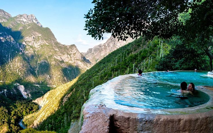 Infinity pools built on the edge of a cliff and filled with a natural mineral spring that's heated by volcanoes...in Mexico...I want to go!