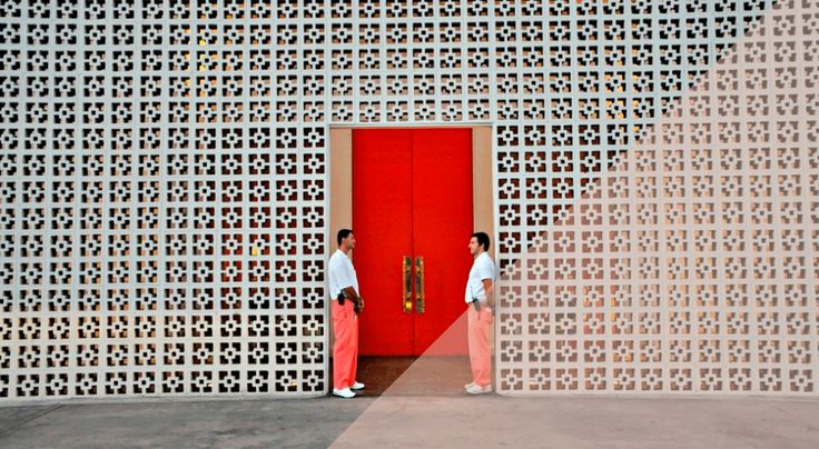 Love the dramatic entrance created by the breeze blocks and the tall red door.