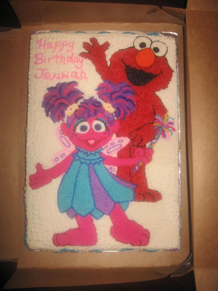 Abby Cadabby & Elmo Cake - This a 12x18 yellow cake with Abby Cadabby and Elmo hand designed out of buttercream icing.