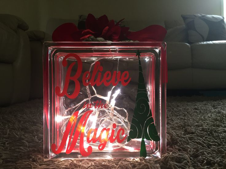 Glass block with slit for the lights to be through. Ribbon, flower & vinyl decal. Took no time at all to put together.