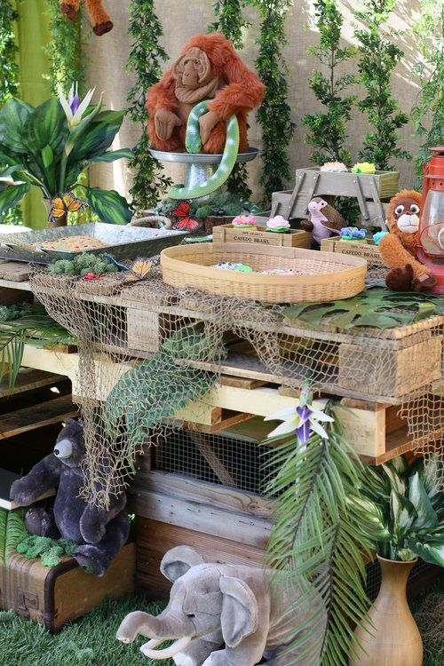 Heaps of luscious green plants, earth worn wood pallets, lanterns, jungle insects, and castaway fishing nets set the stage for all your animal characters to come to life! Everything in our Jungle Adventure Party Collection is prepackaged to rent! @inJOYtheParty