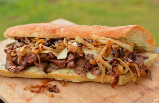 The key ingredients in this Portuguese garlic steak sandwich recipe is garlic, red wine and onions.