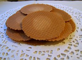 A kniepertie (knijpertje or kniepertje, sometimes iron cake) is a sweet, thin hard waffle traditionally around the old and new year is baked and eaten especially in Groningen. Knieperties are baked in special waffle irons.