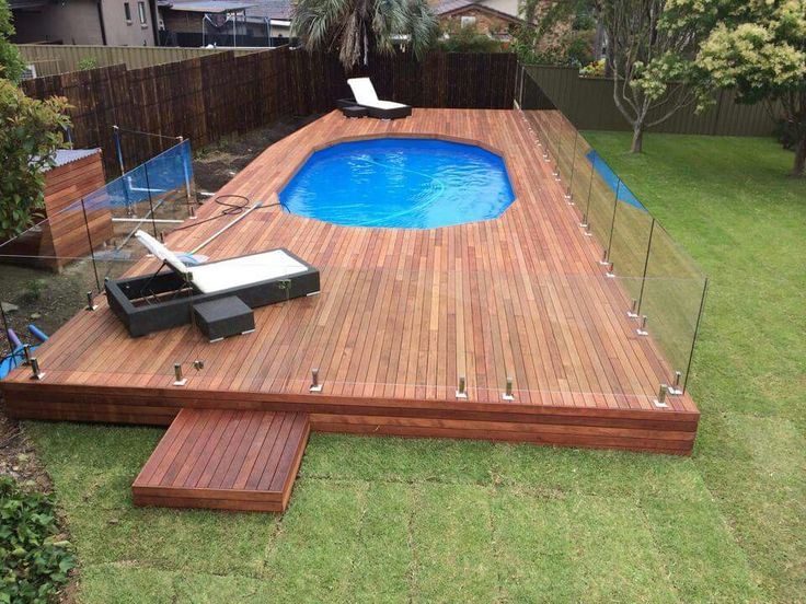 Pool deck, merbau, glass panels.