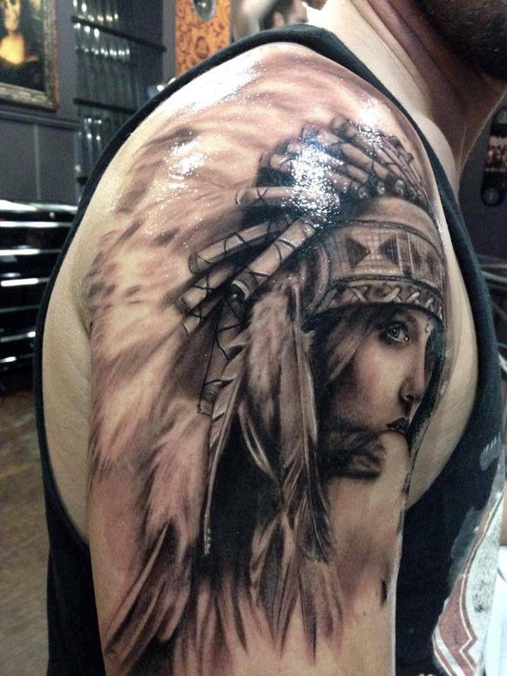 Girl in a feather headdress tattoo.