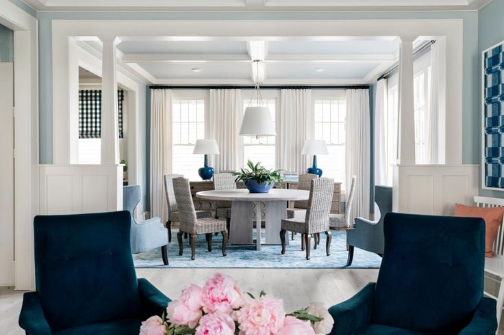 The Chic Technique:  Four plush chairs take center stage in the newly-remodeled dining room and  living room at HGTV Urban Oasis 2017, highlighting the architecture of this Craftsman layout with historical inspiration.