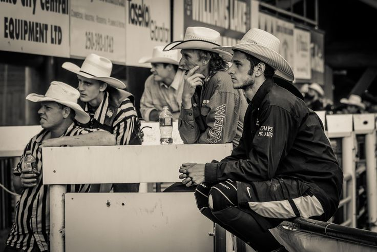 Intense  A group of cowboys by the chutes, watching the mountain race. The mountain race is one of the most dangerous events in the stampede. I stayed away from that one after being warned that horses can veer off course very quickly and pose a threat to photographers nearby.