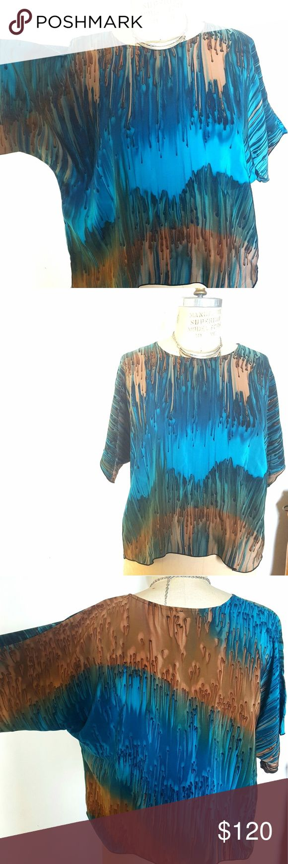 Vintage Dip Dyed Vivid Silk Blouse, Sz M Stunning, vivid hand dyed silk blouse in a size medium.  Velvety soft, the hi-lo cut makes this top a go-to for the holiday season.  Petite batwing sleeves are flattering but can still go under a vest. ❤ Never worn, popping with hues of teal and mocha...a conversation piece and precious addition to any fashion lover's closet! Tops Blouses