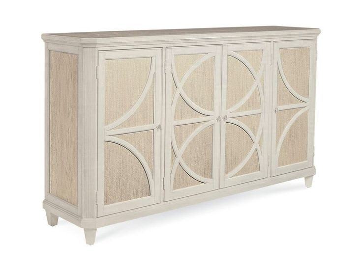 The Sophie Credenza's four doors sparkle with the soft gold of a combed Shimmer finish behind a handsome geometric overlay. The overlay and the rest of the credenza are finished in white Stucco paint that has been lightly distressed to bring out the grain of the wood. The credenza's closed cabinets have fixed and adjustable shelves.