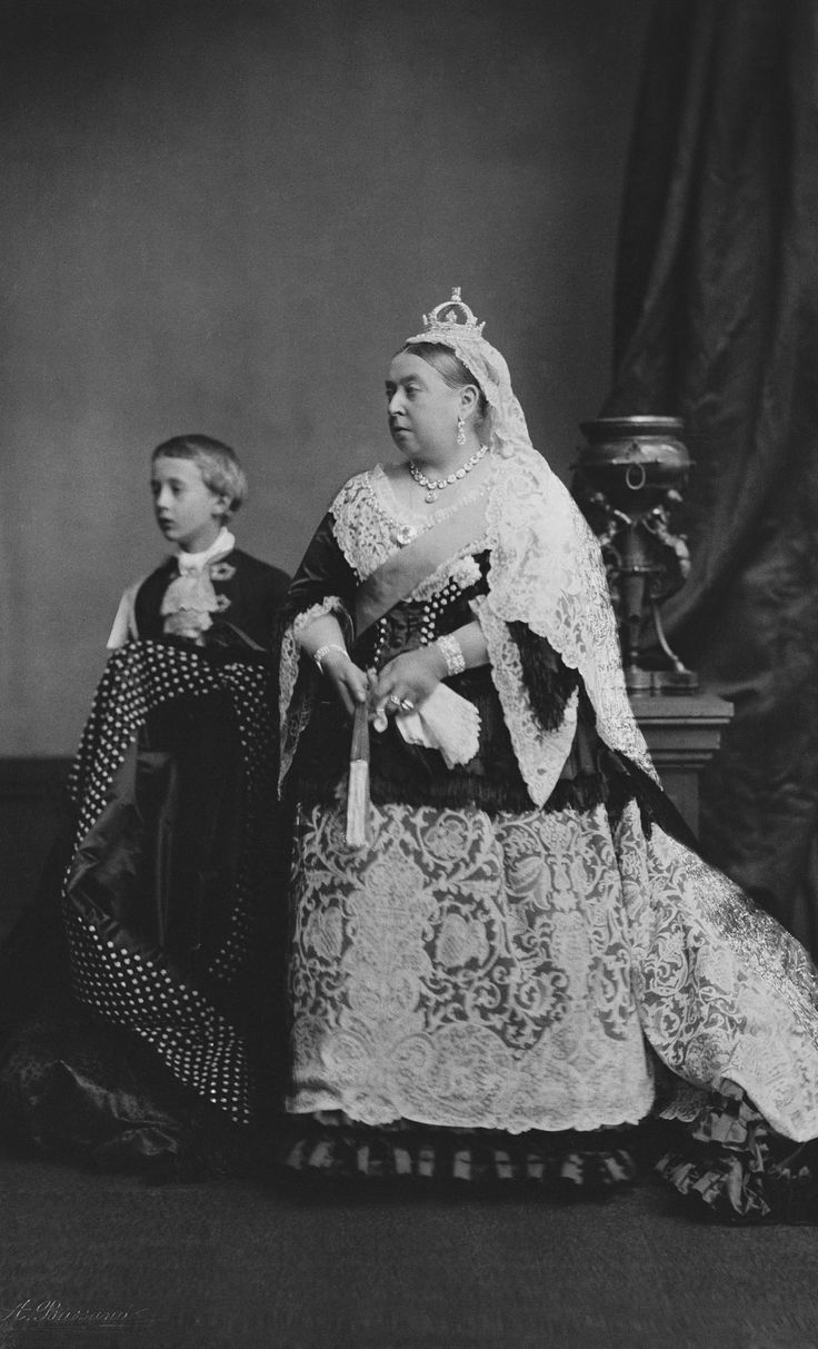 'Queen Victoria and her page, Arthur Ponsonby | Royal Collection Trust'. The Queen wears her wedding veil and large skirt flounce.These were specially made in Honiton as the Queen wished to support English lace-makers.