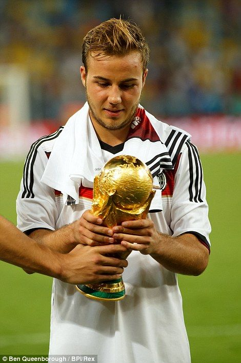 Victorious: Mario Gotze of Germany celebrates by kissing the FIFA World Cup trophy...