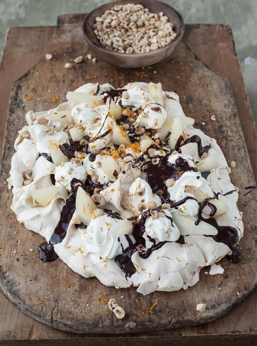 tray-baked meringue with pears, cream, toasted hazelnuts & chocolate sauce