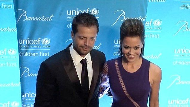 43 Brooke Burke-Charvet and her husband David Charvet stop for photographs at the 10th Annual Unicef Snowflake Ball held in New York.