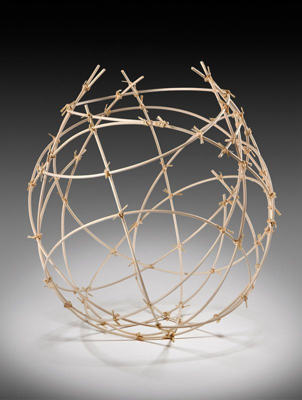 "Jennifer Liston Dykema - Fiber - Linear Basket. Natural reed with raffia. 19""h x 16""w x 16""d."