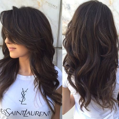 long layered hairstyle for thick hair- curl with barrel curler and alternate directions. Tease bangs and curl ends