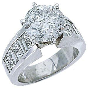 18k White Gold 6.05 Carats Round Princess & Baguette Cut Diamond Ring....Yes if anyone is interested I'd like one