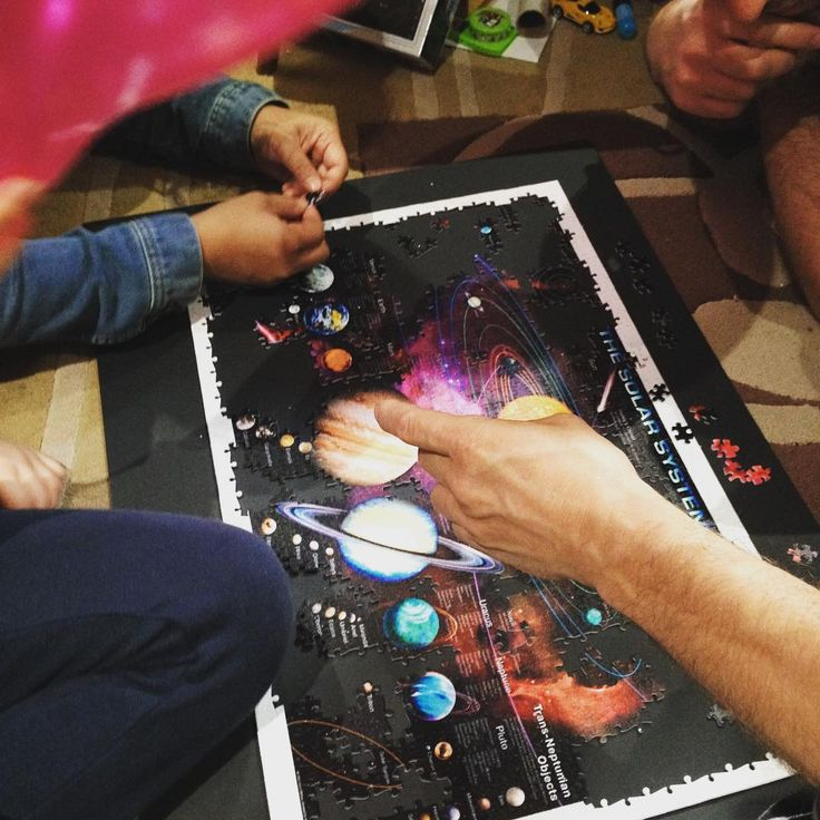 How many people does it take to finish a 1,100 pieces jigsaw puzzle? --> Heebie Jeebies Solar System puzzle