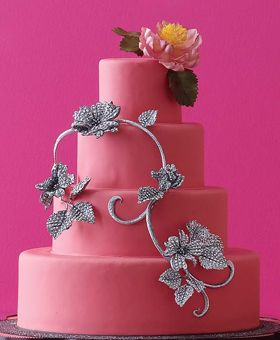 Ron Ben-Israel Cakes, New York City    When Ben-Israel spied an ornate Boucheron diamond-set necklace, a vine-centric cake design was born. Raspberry fondant cake with edible silver leaves and jeweled sugar flowers. 20 dollars per slice, serves 150; weddingcakes.com.
