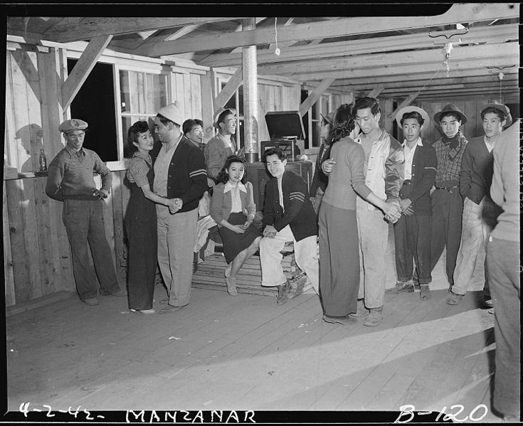 Dancing for recreation, Manzanar Relocation Center, 2 April 1942, Clem Albers, public domain via Wikimedia Commons.