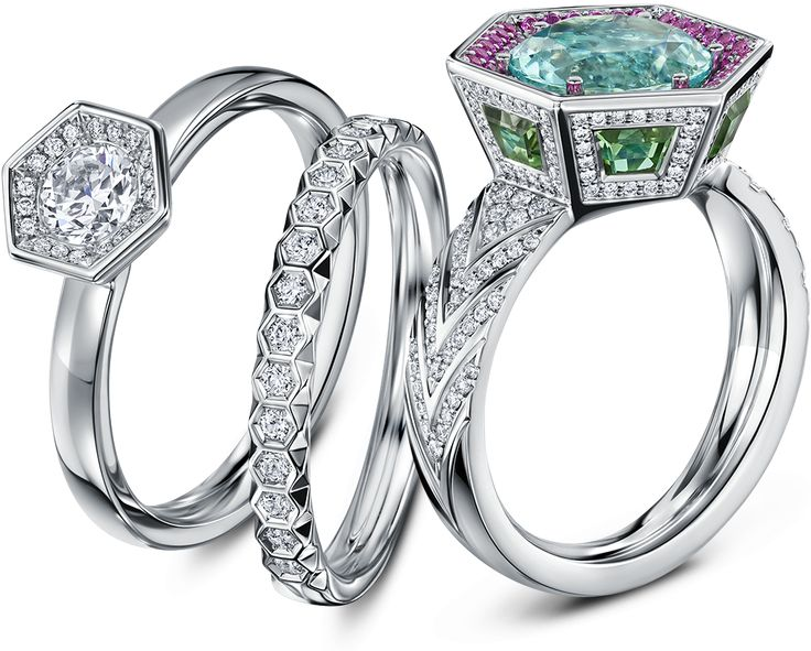 Every facet of this breathtaking cocktail ring is a canvas for an extravagant collection of stones, the angles of the hexagonal setting echoed in falling chevrons of diamonds through the band. Chapiteau's lavish, angular centre uses depth, space and light to add drama to an irresistibly alluring blue Paraiba tourmaline, lauded above a coterie of …