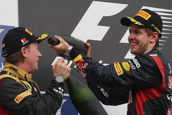 Kimi Raikkonen (FIN) Lotus F1 and Sebastian Vettel (GER) Red Bull Racing celebrate on the podium.  Formula One World Championship, Rd4, Bahrain Grand Prix, Bahrain International Circuit, Sakhir, Bahrain, Sunday, 22 April 2012