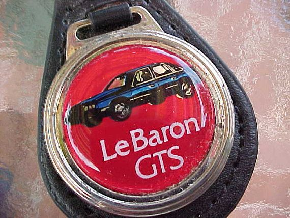 Circa Vintage 1980s Chrysler LeBaron GTS Mopar Classic Car logo Old School Logo Red Suede Key Fob that is in New Old Stock Never Used Condition. Great 1 Diameter Logo that still Shines. These are hard to find now. The company that manufactured these is now long gone. USA Made. Great Key Holder for the Classic LeBaron Lover, Owner and Driver! A Must-Have. It is the only one that I have to offer to you. Scarce Automobile Memorablia at a price you can afford. First Class USPS Mail wiil be $3.50…