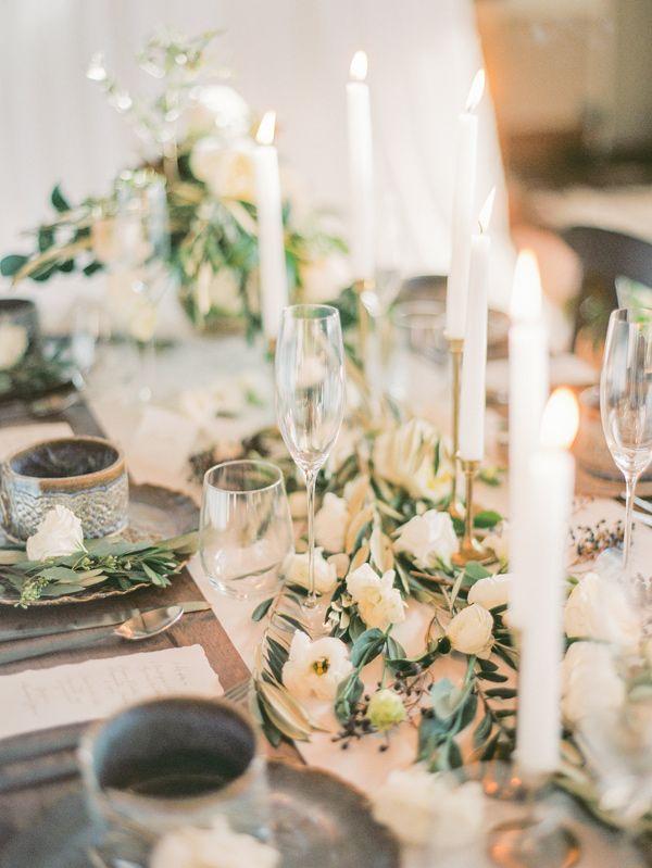 white floral centerpiece - photo by Alyssa Nikole Photography http://ruffledblog.com/romantic-styled-winter-wedding
