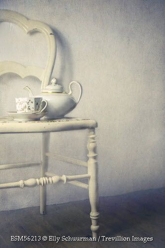 Trevillion Images - teapot-and-cup-on-chair