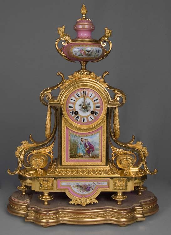 French antique clock set in pink jewelled porcelain and ormolu with silver highlights. - Gavin Douglas Antiques