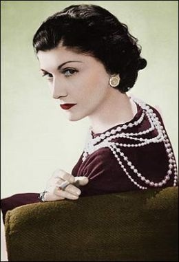 Coco Chanel in 1936, with her red lipstick and ever present strands of pearls