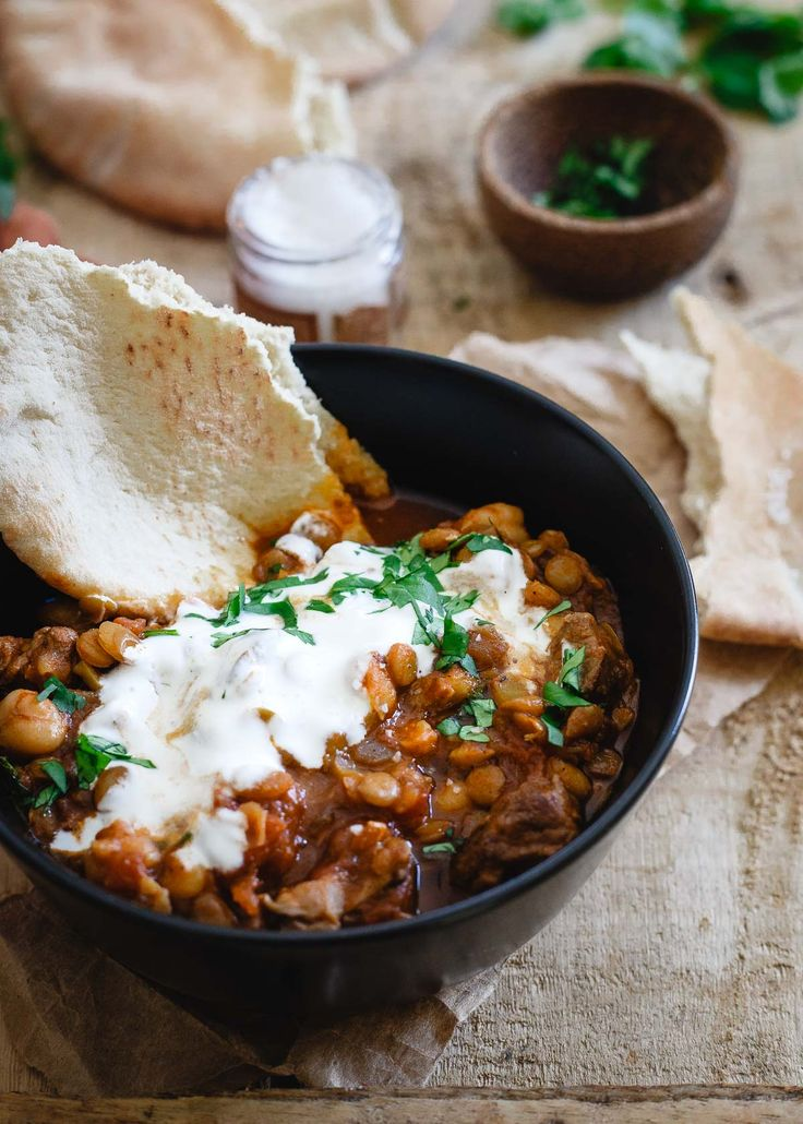 Serve this Moroccan lamb lentil stew with lots of fresh cilantro and a dollop of yogurt to complement the warming pungent spices.