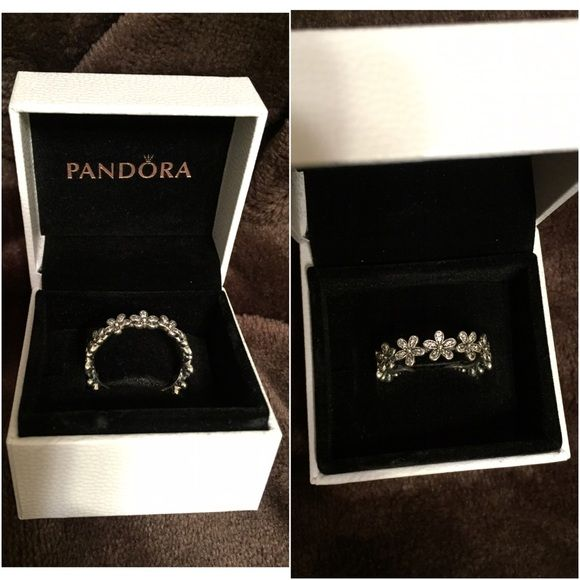 Pandora Dazzling Daisy Meadow Ring beautiful Pandora ring! Received as a gift but a little too big for me! Looks super cute stacked with other rings as well. I can put up additional pictures if needed! Pandora Jewelry Rings
