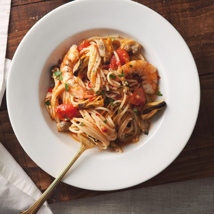 Spaghetti with Mussels, Clams and Shrimp - http://www.foodandwine.com/recipes/spaghetti-mussels-clams-and-shrimp