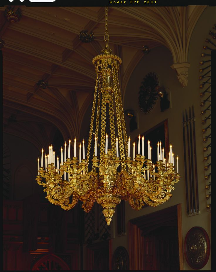 A Sixty Light Gilt Bronze Chandelier Richly Chased Throughout With Foliage Scrolls And Flowerheads