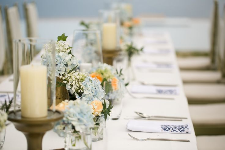 Blue Hydrangea, Baby Breath & Peach Rose posies on Dinner Table