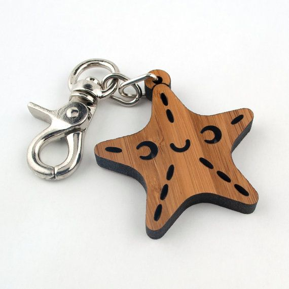 Our cute wood Starfish Purse & Bag Charm is laser cut in 1/4 bamboo from our original Graphic Spaces kawaii artwork. Our ocean star fish can