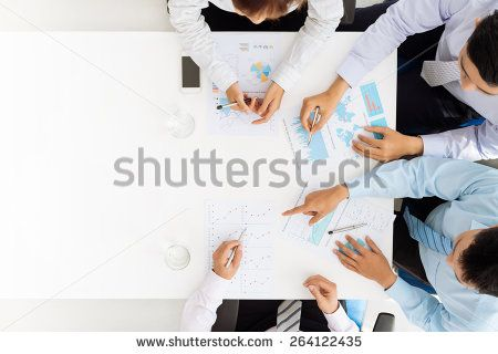 Business team analyzing financial documents - stock photo