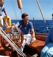 President Kennedy at the wheel of the U. S. Coast Guard yacht Manitou, 26 August 1962.