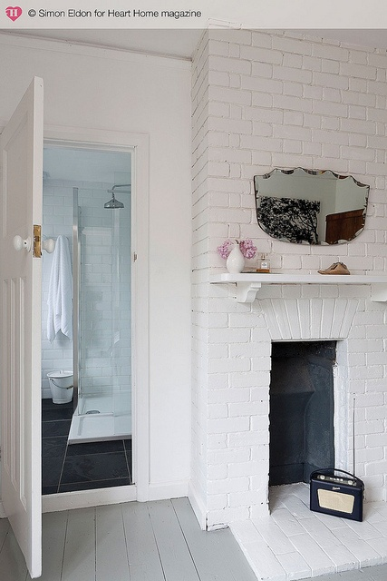 white brick wall and fireplace in master bedroom of sandways holiday beach cottage of the partridges in camber sands, available for seasonal letting (photo by simon eldon for heart home, summer '12 issue)