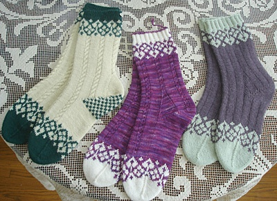 The stranded color design for these stockings was inspired by a stitch pattern in Alice Starmore's book, Charts for Colour Knitting (1992).