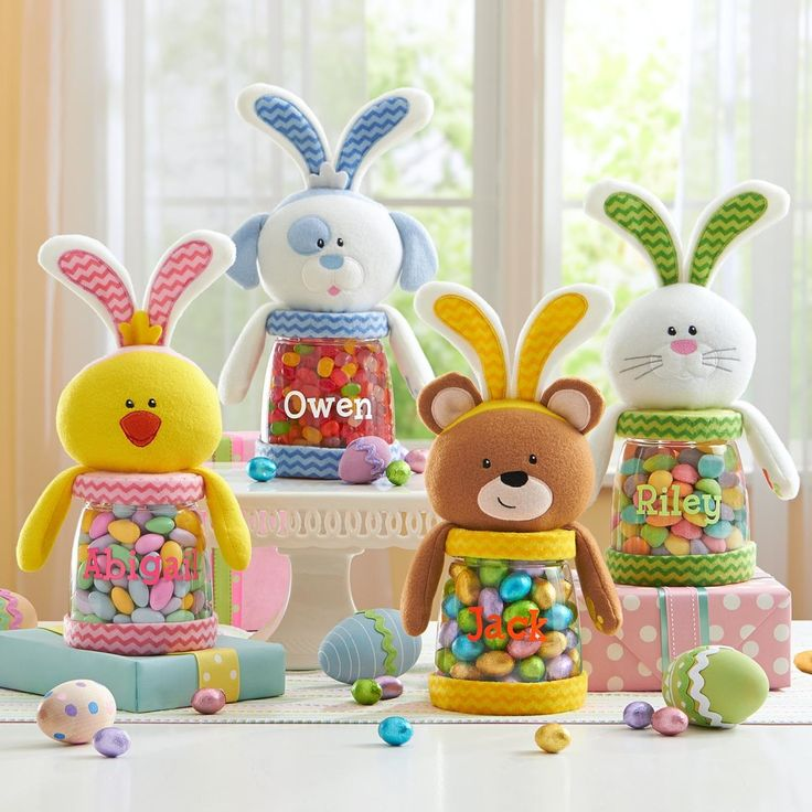 Easter Treat Jars Bunny Chick Puppy Or Bear! So cute I want them all, fill them with candy and you will have a great gift! Your kids will love that they are personalized with there own name on them!!  Having their very own cute little pal to display their Easter treats is sure to make snacks even sweeter! http://kittykatkoutique.com/easter-treat-jars-bunny-chick-puppy-or-bear/