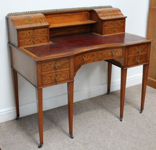 A lovely example of a antique Edwardian satinwood Carlton house desk. A really lovely quality Desk with a small brass gallery along the back.