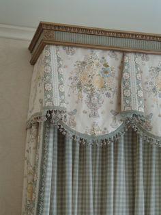 beautiful wood cornice with fabric valance and drapes