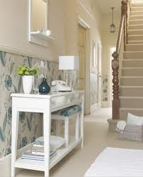 A hallway with dado rail but the added wow factor and interest of wallpaper and some accents