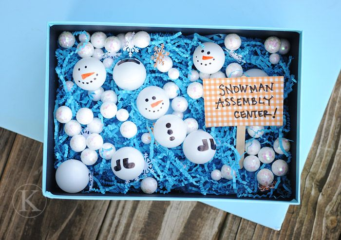 Put Ping Pong Balls with velcro into sensory bucket for Snowman Assembly