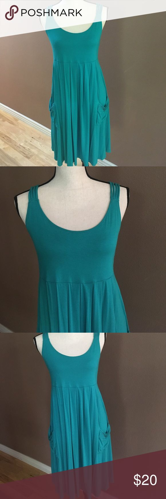 CALVIN KLEIN Strappy Sundress Calvin Klein's ready for summer, strappy dress has an empire waist and pockets on front. Fabric is 95 rayon/5 spandex for great draping. Very good pre-owned condition. Calvin Klein Dresses Midi
