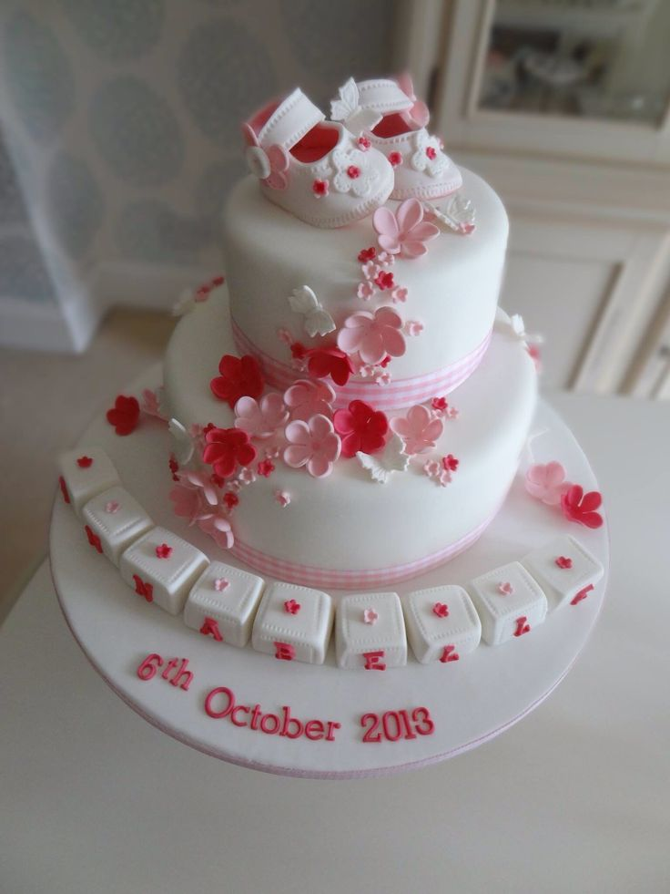 Rachels Enchanting Creations - 2 tier girls christening cake with little booties, building blocks and scatter flowers x