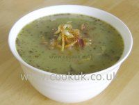 Pea soup topped with fried onions