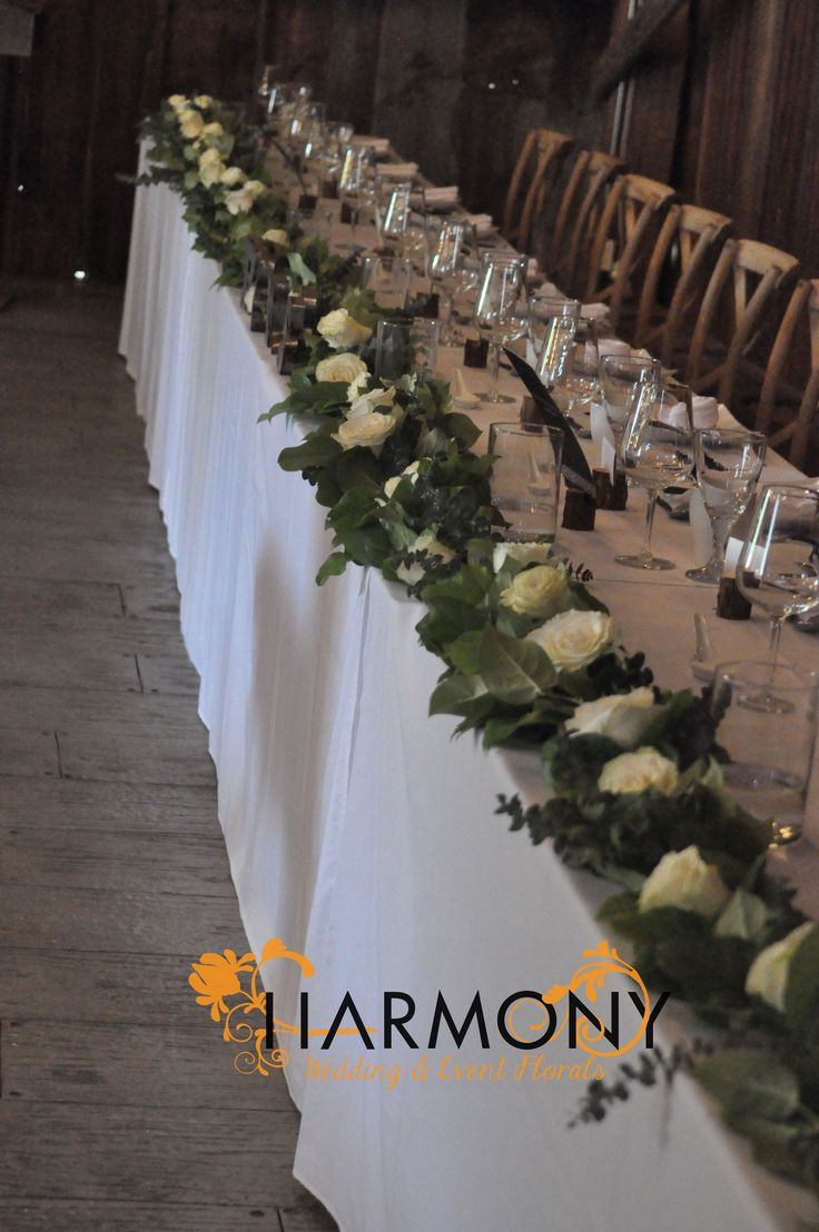 Head-table greenery garland with white #roses